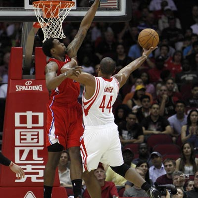The Rockets' Chuck Hayes (44) connects for 12 points and 13 rebounds during a win over the Clippers.   (Getty Images)