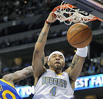 Kenyon Martin dunks in the second half of a rout where nine Nuggets players finish with double figures. (AP)