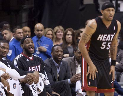 The 'Heatles' look on as Eddie House leads the way for Miami with a career-high 35 points on 27 shots.  (AP)