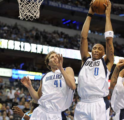 Dirk Nowitzki and Shawn Marion go for a rebound as the Mavs finish the season with a beatdown of New Orleans.  (US Presswire)
