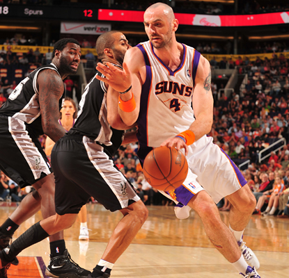 Marcin Gortat contributes 21 points and 13 rebounds to the Suns' win, which cost the Spurs a chance at home court.  (Getty Images)