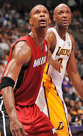 Chris Bosh starts for the Heat and Lamar Odom comes off L.A.'s bench, but they will often match up in crunch time. (Getty Images)