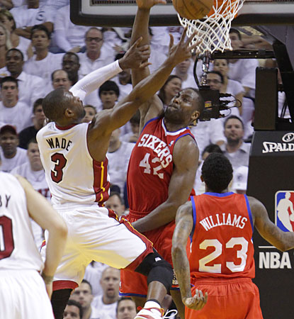 Miami's Dwyane Wade returns after missing a day of practice due to a migraine to score 14 points. (AP)