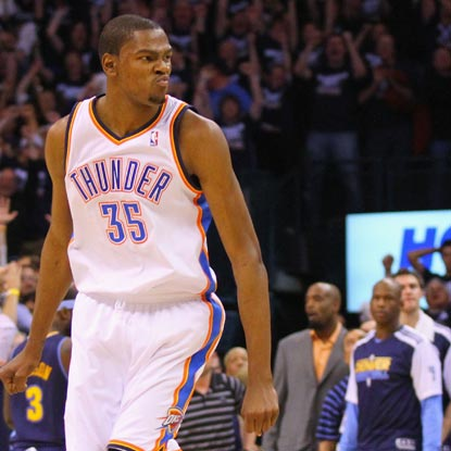 Kevin Durant -- 41 points -- scowls after hitting a huge three-point bucket late in the fourth.   (US Presswire)