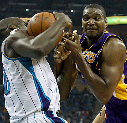 Andrew Bynum battles for a rebound vs. Hornets center Emeka Okafor. The Lakers big man finishes with 18 points and 12 boards. (US Presswire)