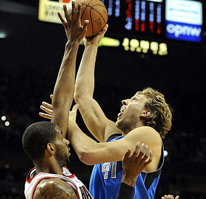 Dirk Nowitzki battles for a bucket over Blazers big man LaMarcus Aldridge in Game 6, scoring a game-high 33 points in the win. (Getty Images)