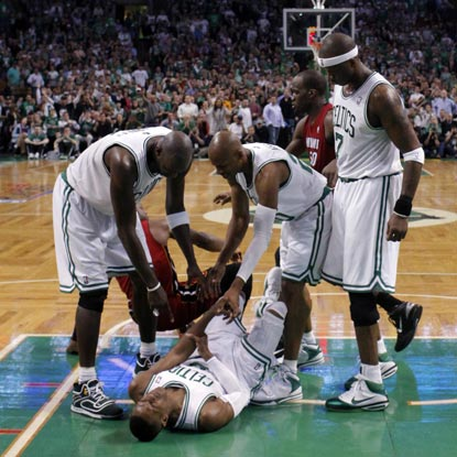 Celtics players attend to Rajon Rondo after he suffers a dislocated elbow in Game 3. (Getty Images)