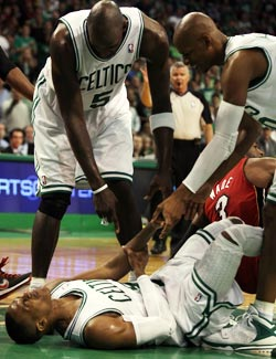Writhing in pain, Kevin Garnett keeps telling Rajon Rondo to 'breathe.' (Getty Images)