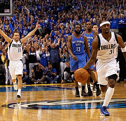 The Mavericks break out in celebration as the seconds wind down in their clinching victory in Game 5.  (Getty Images)