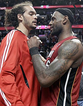 LeBron James is all smiles after the game. Joakim Noah on the losing side does not share his enthusiasm. (AP)