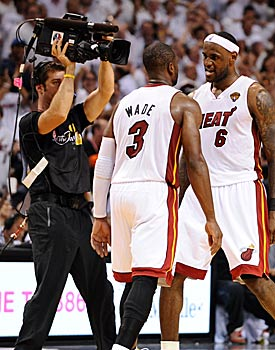 This isn't the first time LeBron James and Dwyane Wade have celebrated prematurely. (Getty Images)