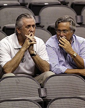 Pat Riley and Mickey Arison face some big decisions in this uncertain offseason. (AP)