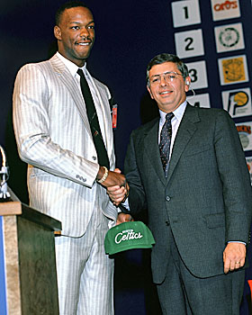Bias shakes hands with David Stern on draft night, 1986. (Getty Images)