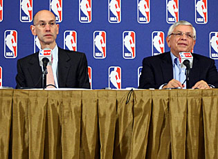 Deputy commissioner Adam Silver (left) and commissioner David Stern address questions after announcing the lockout. (Getty Images)
