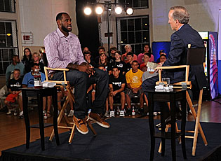 LeBron James and ESPN's Jim Gray prepare for the broadcast of 'The Decision' last year. (Getty Images)