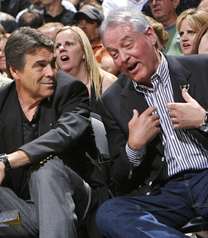 Labor hardliner Peter Holt (right, with Texas Gov. Rick Perry) got $145 million in public help to build a home for his Spurs. (Getty Images)