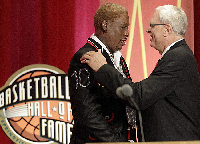 Former Bulls coach Phil Jackson ushers Class of 2011 inductee Dennis Rodman into the Hall of Fame. (AP)