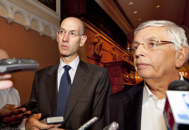 David Stern (right) and Adam Silver, deputy commissioner, face questions after the latest talks. (Getty Images)