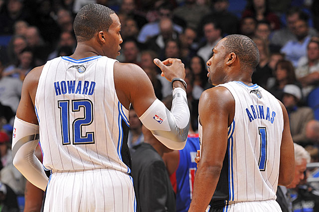 Dwight Howard earns by putting butts in seats; Gilbert Arenas is more likely to drive 'em away. (Getty Images)