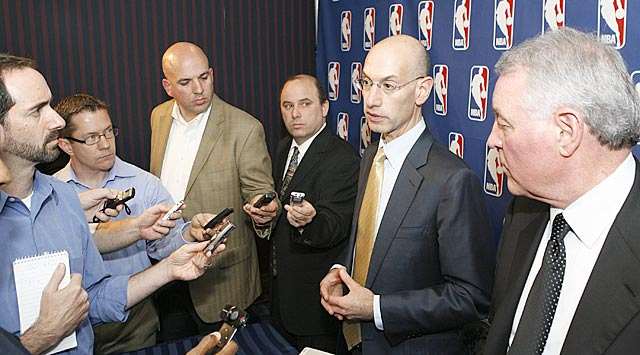 Forgive Ken Berger (second from left) if he seems unenthused about any future negotiations. (Getty Images)