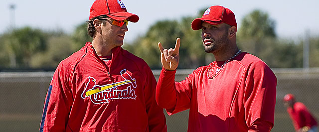 Matheny (left) will debut as the Cards' new manager in the midst of Albert Pujols' free agency. (Getty Images)