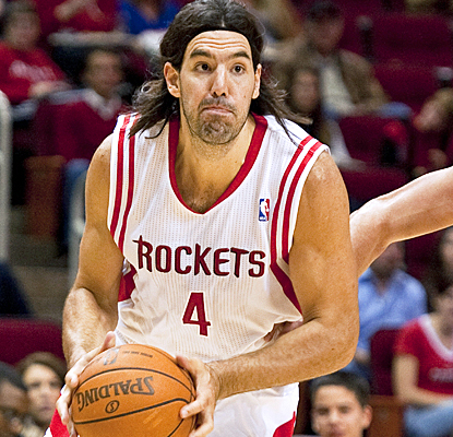 Houston's Luis Scola drives past the Spurs for 20 points and five rebounds. (AP)