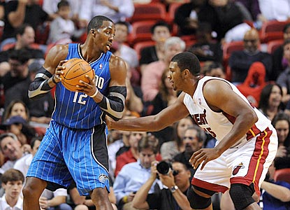 Dwight Howard tries to find a way around Dexter Pittman during the second half.  (US Presswire)