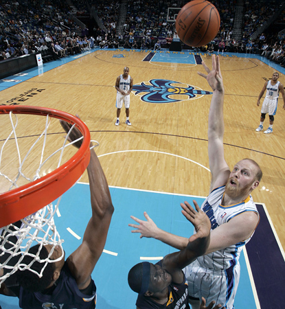 Chris Kaman goes up strong for two of his 18 points in his first appearance for the Hornets. (Getty Images)