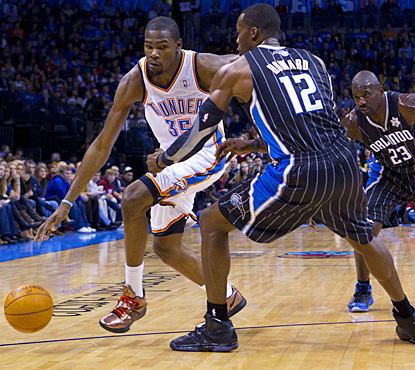 Dwight Howard and the Magic are no match for Kevin Durant (left), scoring 30 points in the win. (US Presswire)