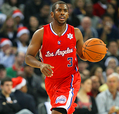 Chris Paul wastes little time in impressing the Clippers, scoring 20 points and nine assists. (Getty Images)