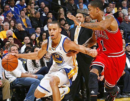 Stephen Curry drives past Derrick Rose and the Bulls for 21 points, 10 assists and seven rebounds. (Getty Images)