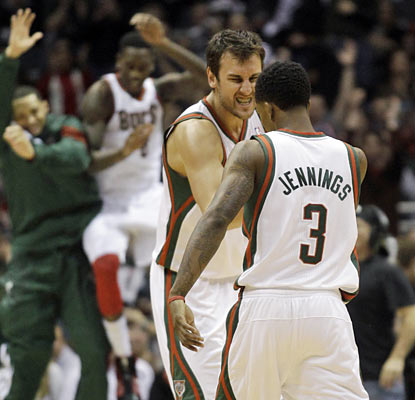 The Bucks' Andrew Bogut and Brandon Jennings combine for 39 points, 12 rebounds and 10 assists in the win. (AP)