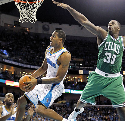 Trevor Ariza and the Hornets jump ahead of the Celtics early and never look back en route to a 19-point rout. (AP)