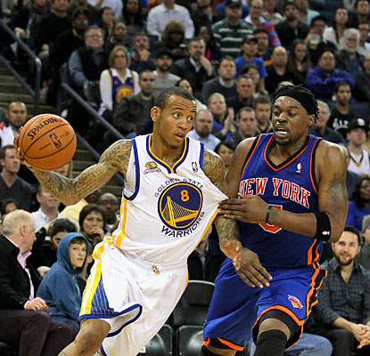 Monta Ellis (22 points, eight assists) and the Warriors use a dominant fourth quarter to push the Knicks aside. (Getty Images)