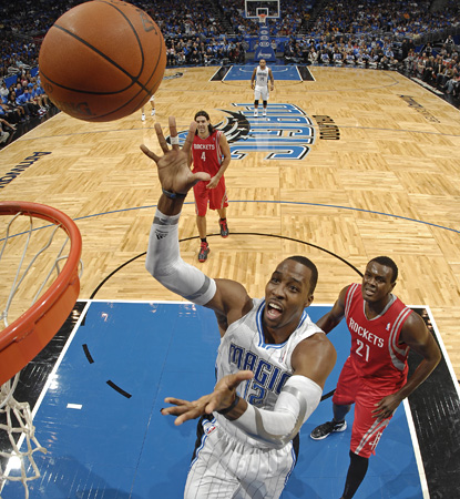 Dwight Howard skies high for one of his 24 boards on the night.  He adds 16 points to his totals. (Getty Images)