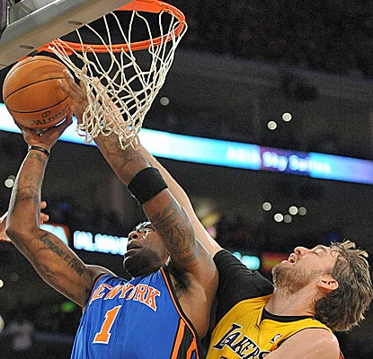 Pau Gasol outscores Amar'e Stoudemire 16-15 and also grabs 10 boards in the Lakers' win. (US Presswire)