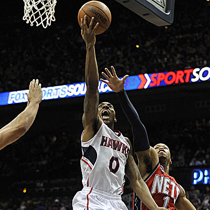 Jeff Teague pours in 22 points and collects six assists (both team highs) in Atlanta's win. (US Presswire)