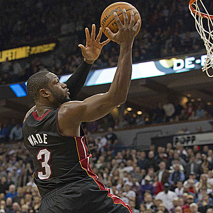 Dwyane Wade converts an alley-oop pass from LeBron James with 4.6 seconds on the clock to give the Heat the victory. (US Presswire)