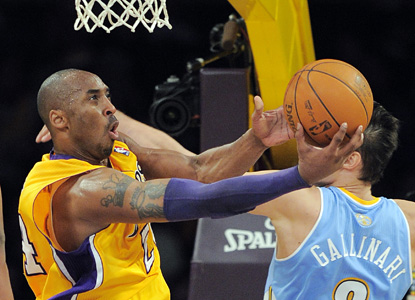 Kobe almost gets a triple-double (17 points, nine assists and 10 boards), despite foul trouble. (AP)