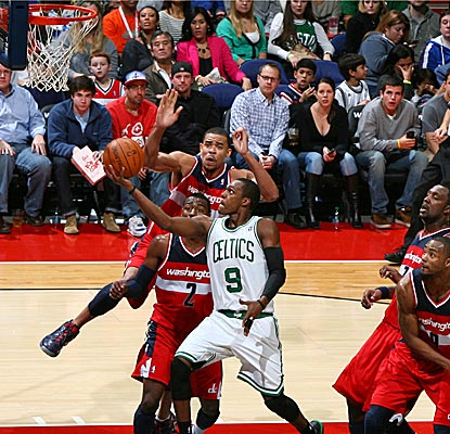 Rajon Rondo gets a quick start on his statistical feat by notching six assists in the first eight minutes of the game.  (Getty Images)