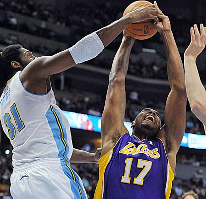Nuggets center Nene comes up with one of his four blocked shots on the Lakers' Andrew Bynum. (Getty Images)