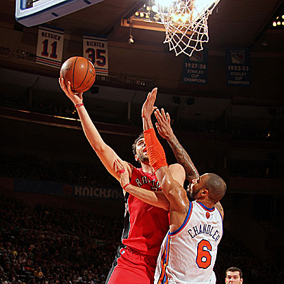 The Raptors' Andrea Bargnani goes over the Knicks' Tyson Chandler for two of his 21 points. (Getty Images)