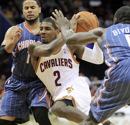 Kyrie Irving drives through the Charlotte defense on his way to netting 23 points for Cleveland.  (AP)
