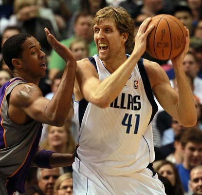 Dirk Nowitzki plays in the 1,000th game of his NBA career and scores 20 to pace the Mavericks.  (Getty Images)