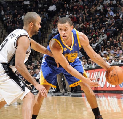 Tony Parker squares off against Stephen Curry. Parker nets 21 and Curry 20 before leaving with a sprained ankle.  (Getty Images)