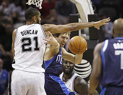 Tim Duncan helps make things tough on Dirk Nowitzki, who suffers one of the worst games of his career.  (Getty Images)