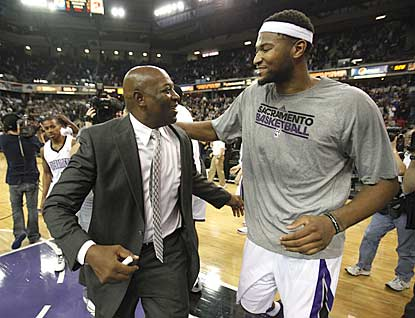 Interim coach Keith Smart and DeMarcus Cousins, who clashed with Paul Westphal, embrace after Sacramento's stunning comeback.  (AP)