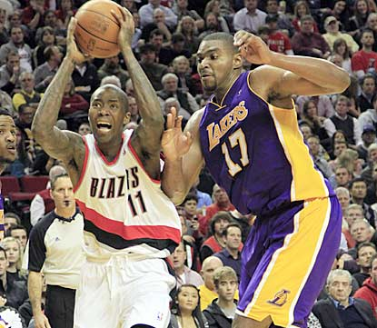 Portland's Jamal Crawford drives around Los Angeles center Andrew Bynum during the second half.  (AP)