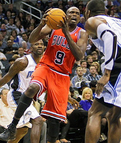Chicago's Luol Deng drives to the basket for two of his 21 points against the Magic. (AP)