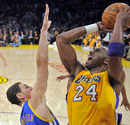 Neither a bad wrist nor a jam-packed schedule slows down Kobe Bryant, who scores 39 points, including 26 in the second half. (AP)